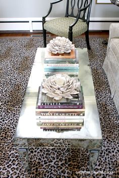 LOVE LOVE LOVE this coffee table. The idea of having mirrored furniture is just SO chic.
