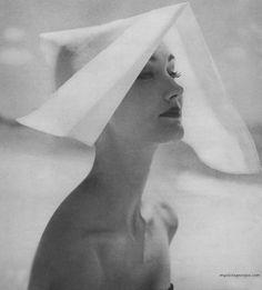 Evelyn Tripp modelling headwear for Harper's Bazaar, May 1954. Photo by Lillian Bassman.