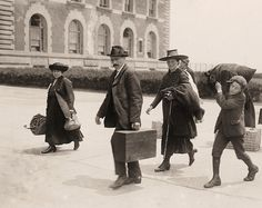 A family arrives at Ellis Island to begin new lives in America. 1910