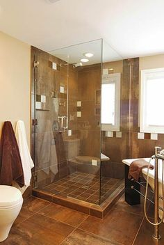 Spalike Bathroom - I love tiled bathrooms and glass showers! This would go perfectly with the dark wood cabinets with two sinks!