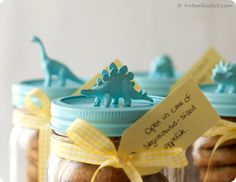 Boy Gift Idea: Dinosaurs spray-painted and glued to top of mason jars filled with cookies. Could do with so many other things too for girls or adults.