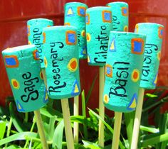 Recycled wine cork garden markers-- you have soooo many wine corks it would be a good use of them :p