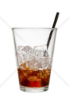 half empty with straw - A half empty glass with a straw sticking out of it
