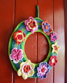 springy flower wreath in crochet from www.flythecoopcrafts.blogspot.com