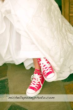 Converse shoes under a long wedding dress. .... Or possibly Grad dress  got my grad idea now