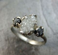 Rough white diamond engagement ring in sterling silver band featuring two…
