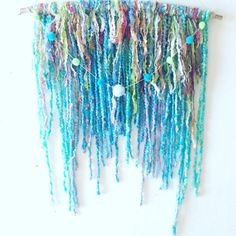 Fiber pom pom wall hanging, hippie wall art, boho wall decoratiom,, room decor, pom pom dreamcatcher, hippie dream catcher by Lovemyartfarm on Etsy https://www.etsy.com/listing/468251693/fiber-pom-pom-wall-hanging-hippie-wall