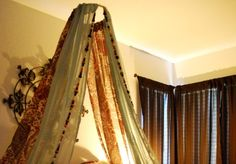 Boho bed canopy - Easy DIY with a large embroidery hoop, several panels of sheer fabric & add some strands of beads if they suit your style.