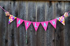 Girls Birthday Banner  Girls Name Pennant Banner  by LaLaLolaShop, $22.00 -- I like the pom poms as bookends and the mix of solid colors with patterned.