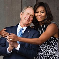 A much-needed sign of political civility: First Lady Michelle Obama gives former President George W. Bush a big hug at the opening of the National Museum of African American History and Culture. President Bush signed the bill authorizing the NMAAHC in Michelle Obama, Black Presidents, American Presidents, Joe Biden, Durham, George W Bush, Rodney King, Donald Trump, Presidente Obama
