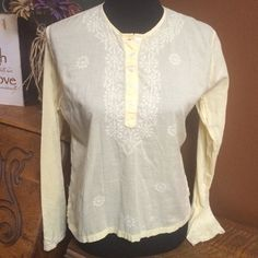 LT YELLOW FREE PEOPLE LONG SLEEVE TOP This FREE PEOPLE top is light yellow and a bit see through. It has long sleeves and some beautiful embroidery on it. It's a subtle hi low. 5 buttons go from collar on down. Very nice top Free People Tops Blouses