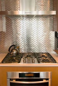 silver backsplash kitchen Collection-The silver tile backsplash is a nice contrast to the wood finishes in the kitchen from Silver Backsplash Kitchen Photos. Taken from Misc category. Küchen Design, Tile Design, Design Ideas, Stainless Backsplash, Granite Countertops, Small Tiles, The Tile Shop, Kitchen Backsplash, Backsplash Ideas