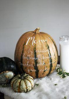 Thanksgiving menu written on a pumpkin