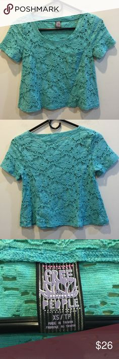 FREE PEOPLE Turquoise Blue Lace Shirt Free People shirt with a lace like body that is not lined and has short sleeves. Free People Tops Blouses