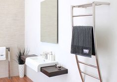 DC Short Tira Heated Towel Rail The Tira combines its unique angular design (bulky towels won't overlap) with the added functionality of a heated top shel| Sydney Tap and Bathroomware