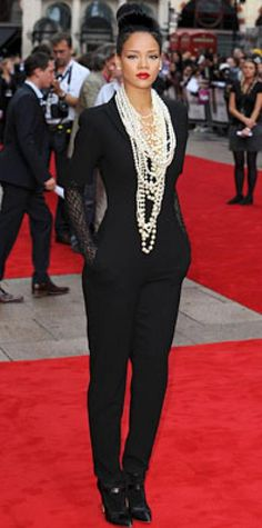 Look of the Day › July 24, 2009 WHAT SHE WORE Rihanna added ropes of pearls and long lace gloves to a short-sleeve jumpsuit from Alexander McQueen WHERE The London premiere of Inglourious Basterds