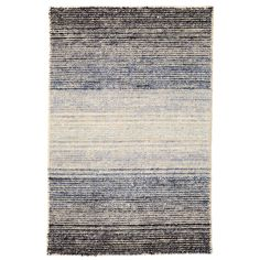 Be transported with this woven wool/viscose area rug in varying shades of a clear nights sky. Featuring a beautiful ombre effect, soft, nubby pile, and slightly mottled appearance, this rug is a clear choice for showcase spots like the office, master bedroom, or living room.   Viscose-blend rugs offer the same lush feel underfoot as silk, but at a more affordable price. The delicate fibers of viscose-blend rugs are best suited for low-traffic, gently used rooms only. Not suitable for homes…