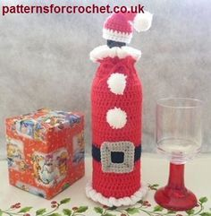 Free crochet pattern Santa bottle cozy and hat usa.  FREE PATTERN 5/14.                                                                                                                                                                                 More