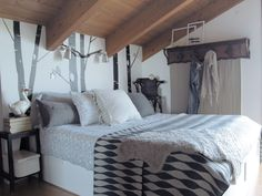 master bedroom-contact paper birch trees on the wall