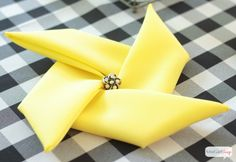 Quick and easy video tutorial on how to fold napkins into a pinwheel shape. This trick works with cloth napkins or paper napkins. Such a fun touch for a summer party or a carnival theme event.