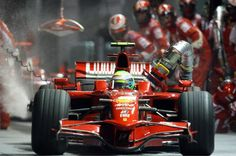 Brazilian driver Felipe Massa of Ferrari leaves the pits with the fuel hose intact during the final of Formula One's firstever night race at the. Hamilton, Singapore Grand Prix, Track Pictures, Williams F1, The Great Race, Ferrari F1, Sports Games, Formula One, Race Cars