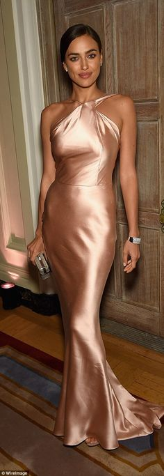 Pretty in pink: Irina looked beautiful in her satin pink number which showed off her supermodel curves to perfection