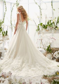 Wedding Dresses and Bridal Gowns by Morilee designed by Madeline Gardner. Classic Tulle Wedding Dress with Crystal Beaded, Lace Appliques and scalloped Hemline