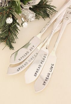 Butter spreaders set of four hand stamped for your holiday party. One each of spread cheer, joy, love and peace. A range of beautiful patterns