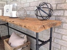 Industrial chic sofa table Table top is salvaged 100 year old barn wood. One solid piece. Legs are made from piping and painted a matte black. Wood Sofa Table, Industrial Console Tables, Sofa Tables, Industrial Chic, Plumbing Pipe Furniture, Reclaimed Wood Furniture, Old Barn Wood, Reclaimed Barn Wood, Rustic Wood