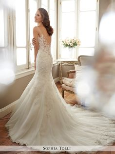 Sophia Tolli - Y11707 Margot - Sleeveless misty tulle fit and flare gown with slender illusion shoulder straps and soft sweetheart illusion neckline edged with crystal hand-beading, beaded lace appliqués generously adorn bodice and trail off down skirt, beaded illusion sides and low V-back adorned in matching appliqué, back zipper trimmed with tulle and satin buttons, chapel length train.Also available with solid back as Y11707SB.Sizes: 0 - 28Colors: Ivory, White
