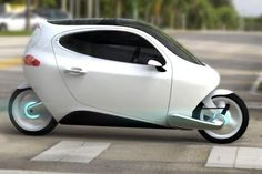"Lit Motors unveils a new electric propotype car called (well over a year ago) Combining the small size of a motorcycle and the safety of a car, this car is also nicknamed ""rolling smartphone"" for its maximal connectiy with mobile devices. Electric Car Concept, Electric Scooter, Electric Cars, Electric Vehicle, Electric Cycle, Lit Motors, Futuristic Motorcycle, Motorcycle News, Kairo"