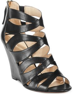 $109, Black Leather Wedge Sandals: Nine West Cronin Wedge Sandals. Sold by Macy's. Click for more info: http://lookastic.com/women/shop_items/125596/redirect