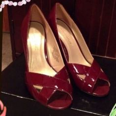 "HpPretty pumps by Banana Republic These are patent leather and a reddish/ maroon color in perfect condition Heel is 3 1/2"" Banana Republic Shoes Heels"