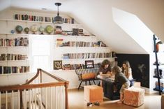 Love the book shelf idea for a sloped ceiling in the gameroom/kids area.