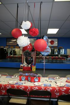 Tissue pom poms and paper lanterns make great decorations. Paper Lantern Making, Paper Lanterns, Karate Party, Joes Bar, Tissue Pom Poms, 8th Birthday, Taekwondo, Bar Mitzvah, Party Themes