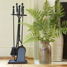 Darby Home Co Topped with traditional turned handles, each sturdy tool in this iron fireplace set will help you build and maintain a cozy fire. Includes poker, brush, shovel, and tongs. Fireplace Glass Doors, Fireplace Tool Set, Traditional Furniture, Traditional Decor, Barrel Stove, Perry Homes, Tabletop Clocks, Fireplace Accessories, Tray Decor