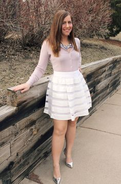 Lilac shirt and white skater skirt with metallic heels