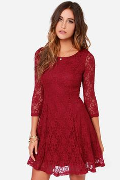 """When it comes to your refined taste, there's no better dress to indulge in than the Fine and Dine Wine Red Lace Dress! Lovely wine red lace covers this fit and flare number, sweeping across a rounded neckline, down three-quarter length sleeves, and into a body-contouring bodice with darted detail. The full circle skirt adds the perfect touch of charm at bottom. Hidden back zipper with clasp. Dress is lined in wine red stretch knit; sleeves are sheer. Model is 5'8"""" and is wearing a size…"""