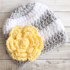 This free large crochet flower pattern is the perfect addition to hats and so much more. Made in half an hour or less, it's a great last-minute gift!