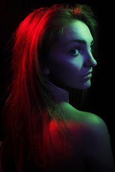 This is a fashion portrait. To take this photo I used three lights with three different coloured gels over the lights. I wanted to create a dramatic mood using colours instead of using facial expressions and poses. I used red, blue and green. I thought that these colours could all communicate something so thats why I chose them. I also used the lighting technique rembrandt lighting by one of the lights being on the right side and up above. I used a black background to make the colours stand…