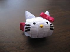 DIY Sculpted Ribbon Hello Kitty Bows.  This website has a bunch of great hairbow tutorials!