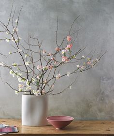 Bouquet Of Branches: Less is more when it comes to woody stems, like quince, cherry, and dogwood. Select just three or four sculptural specimens, and use a heavy oblong vase that's about a third as tall as the branches. Aim for an asymmetrical spray so the branches reach rather than lean.