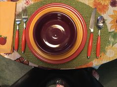 Fiesta® Dinnerware colors for Autumn place setting: Paprika, Marigold and Claret.