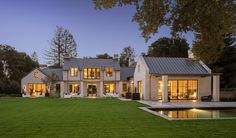 """119 Tuscaloosa Avenue in Atherton, CA is offered at $36,800,000 by Natalie Comartin of Coldwell Banker Residential Brokerage. Built by Woodlane Properties and designed by Arcanum Architecture with landscaping by Studio Green, the estate encompasses two sprawling acres, a 16,000 square-foot main house, a guesthouse, a 50-foot-long swimming pool and a pool house. The property is inspired by northern European architecture, """"uniquely designed as a collection of distinct buildings and living…"""
