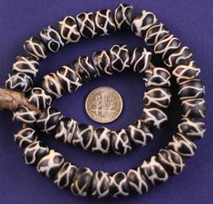 Twisted squares beads  Made in: Holland  Traded in: Africa  Approximate Age: From mid 17th century onwards  Overall Condition: Good, small pitting