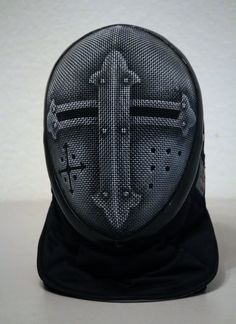 A lot of people paint their fencing masks. But I woulda never thought of painting it to look like a suit of armour mask. Genius!