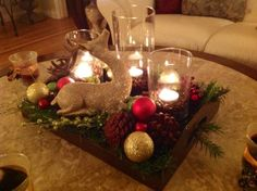 Coffee Table Christmas Decor With Pine Cone And Christmas Ball Plus Candle In Clear Glass Jar Placed On Dark Wooden Trays