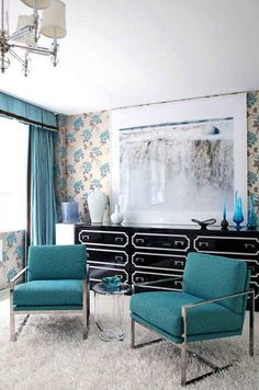 regency glam.  love the black lacquered  campaign style chests, turquoise accents, and shag rug.  cpi studio