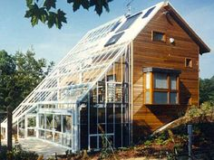 great passive solar design- I would plant row of deciduous trees in front of glass so that in the winter that could act as a giant trombe wall but be shaded to keep it cool in the summer. Trees that max out at 2 stories would allow south face 3rd level roof to accommodate panels!