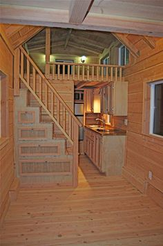 A tiny house on wheels with two lofts and stairs in Felton, California. Designed and built by Molecule Tiny Homes.